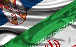 This combination photo shows the flags of Serbia and Iran.