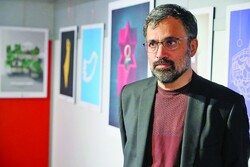 Art Bureau's Visual Arts Center director Masud Shojaei-Tabatabai poses at an exhibition for the Palestine Is Not Alone International Cartoon, Caricature and Poster Contest at Abolfazl Aali Gallery in