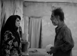 """Mahdieh Nassaj and Ali Baqeri act in a scene from """"The Wasteland"""" by Ahmad Bahrami."""