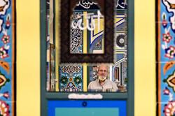 Imam Abu Nahidian is reflected in a mirror at the Manassas Mosque in Manassas, Va., on Aug. 18, 2021. (Katherine Frey/The Washington Post)