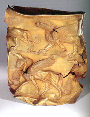 Golden cup depicting griffin on top band. Excavated at Marlik, Gilan, Iran. The first half of the first millennium BC.