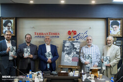 """Writers and some comrades of Seyyed Mehdi Araqi hold copies of """"Kill Mehdi Araqi"""" on the political dissident in a meeting organized at the Mehr News Agency in Tehran on September 11, 2021 to introduce"""