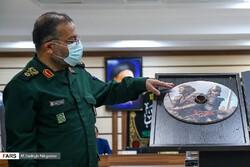 "Basij Organization chief Brigadier General Gholamreza Soleimani unveils a copy of the computer game ""Uprising Season"" in Tehran on September 14, 2021. (Fars/Sdaeq Nikgostar)"