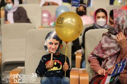 A boy wearing a mask of Ali Landi and his mother attend the opening ceremony of the 34th Isfahan International Film Festival for Children and Youth in Isfahan on October 8, 2021. (ICFF)