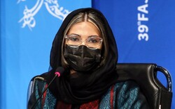 """Iranian director Farnush Samadi attends a press conference after a screening of her debut film """"180º Rule"""" during the 39th Fajr Film Festival in Tehran on February 6, 2021. (IRNA/Marzieh Musavi)"""